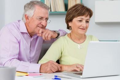 Seniors couple using a laptop computer